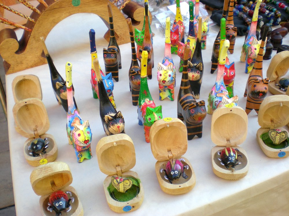 Wooden Cat Ring Holder Statues on display