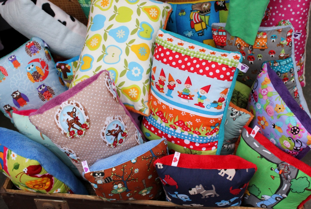 Cushions on display, made with very cute fabric