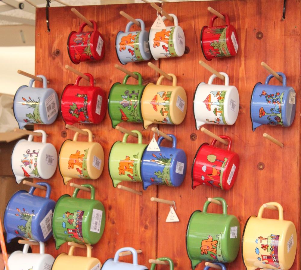 Mugs hanging on a summer market display